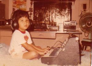 Me aged 5 playing my Dads keyboard