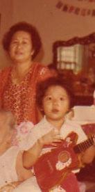 Me aged 5 playing guitar